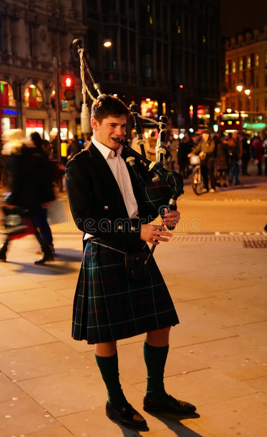 Bagpiper blowing his pipes
