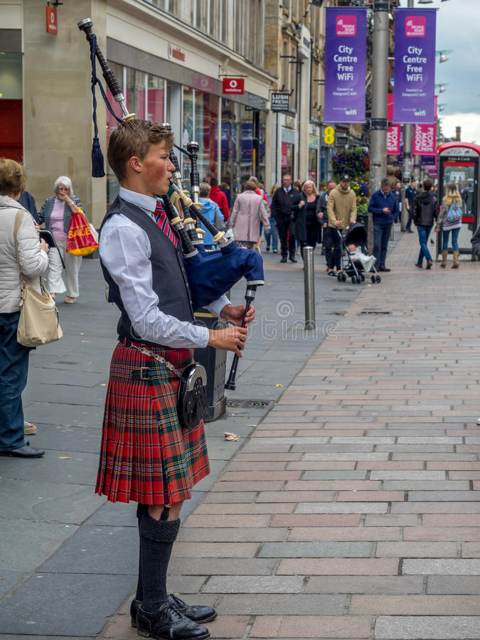 Bagpiper, Buchanan Street, Glasgow stock images