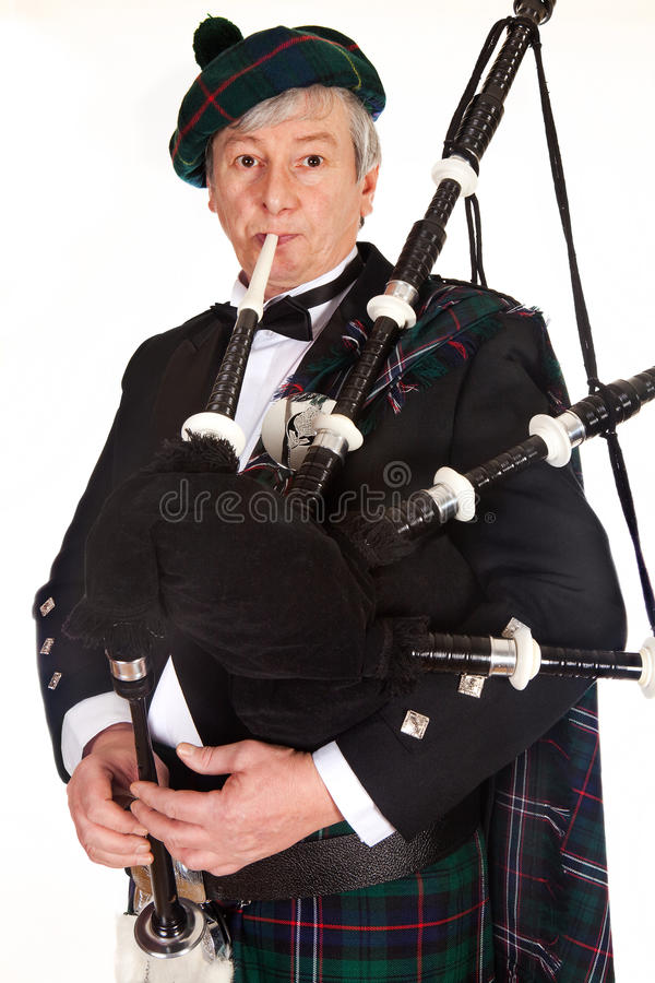 Download Bagpiper in tartan stock photo. Image of jacket, player - 12559140