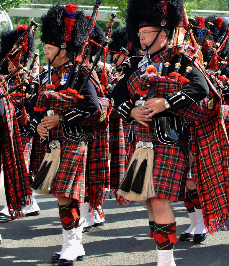 Bagpipers in a parade. Scottish Bagpipers at Edmonton's 2009 Capital Ex parade royalty free stock photo