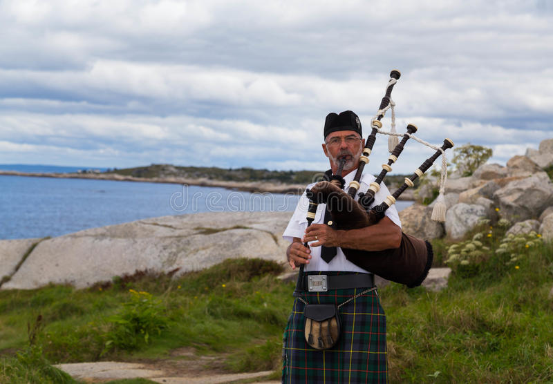 Bagpipes Musician at Peggy's Cove royalty free stock photography