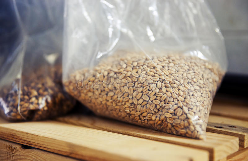 Bags of Barley and Hops for Brewing Beer royalty free stock photos