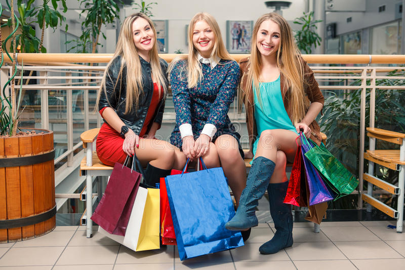 bags beautiful girls isolated shopping three white royaltyfria foton