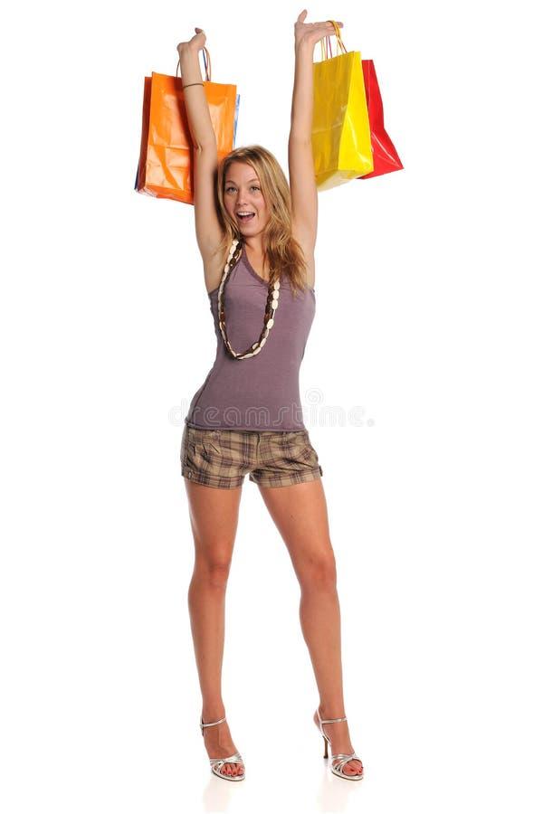 bags blont barn för holdingshoppingkvinna royaltyfri foto