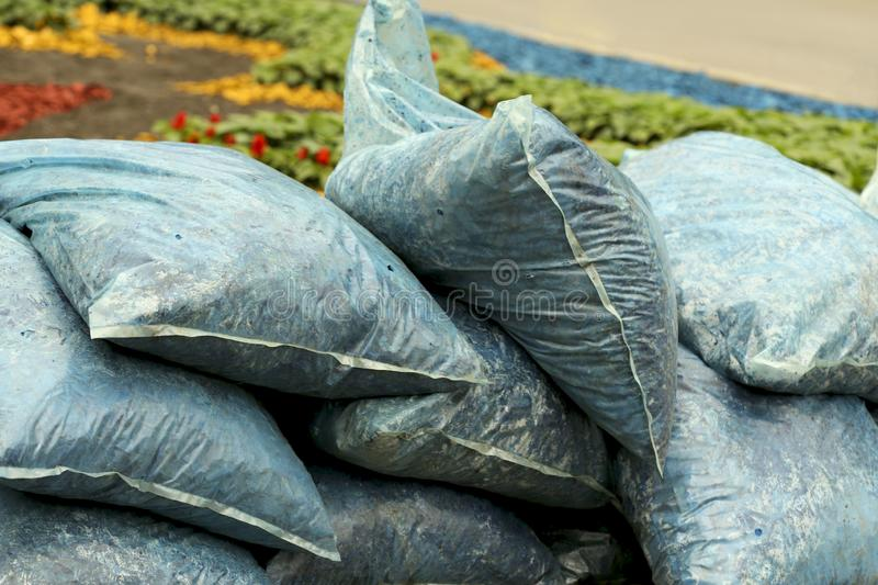 Bags with blue natural material for soil mulching. stock images