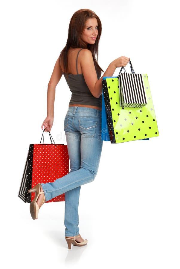 bags den färgrika shoppingkvinnan royaltyfri foto
