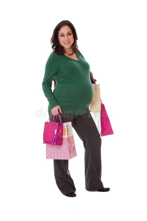 bags den gravida shoppingkvinnan arkivfoto