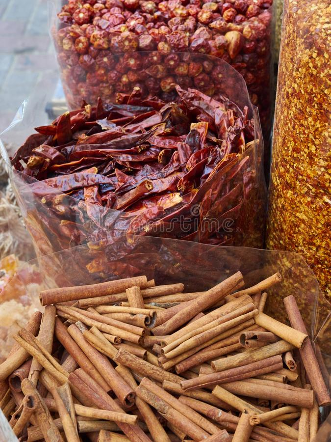 Bags of dried chillies and cinnamon sticks stock images