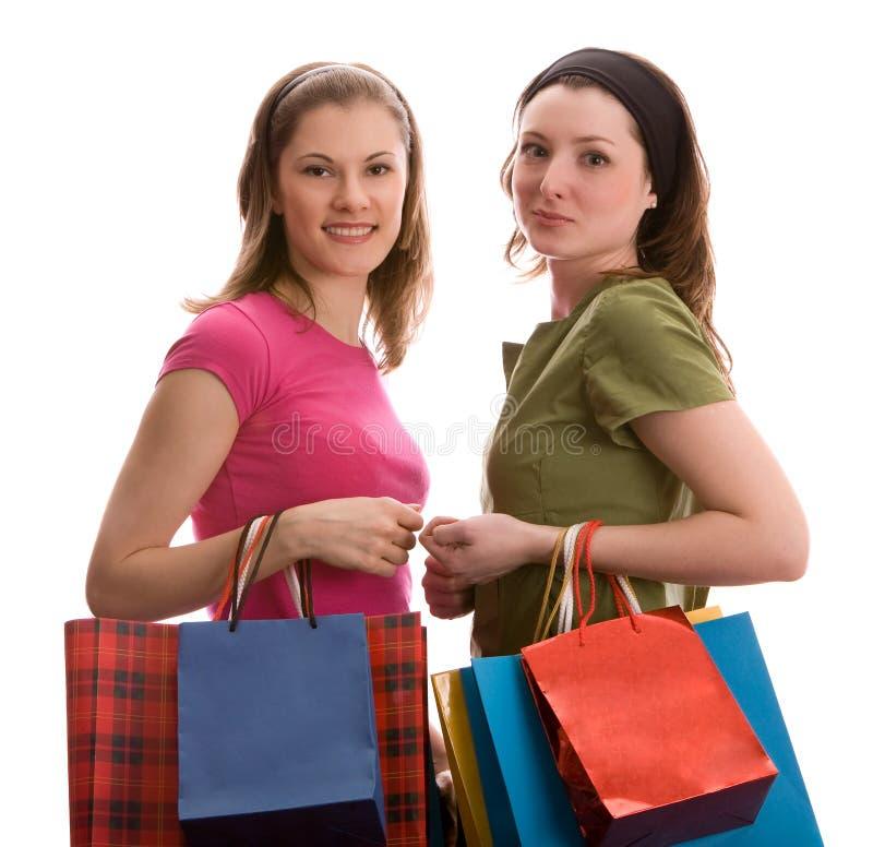 bags girls isolated shopping two white royaltyfri fotografi