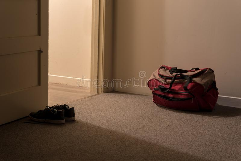 Bags packed and shoes laid out ready for departure stock photos