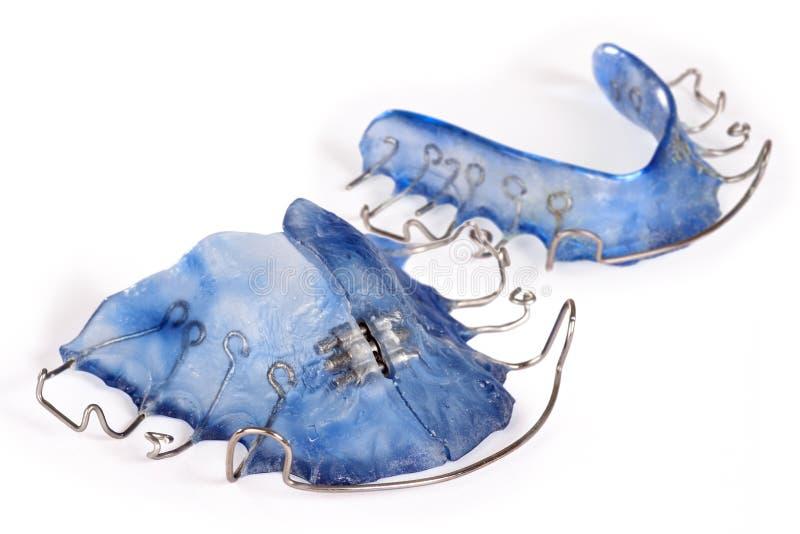 Bague dentaire bleue, orthodontia image libre de droits