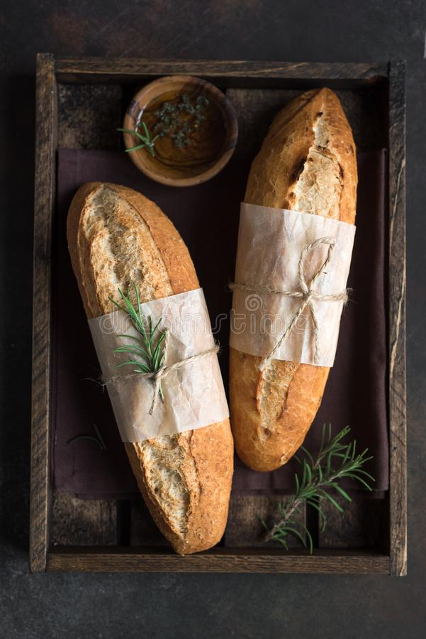 Baguette bread with rosemary stock photo