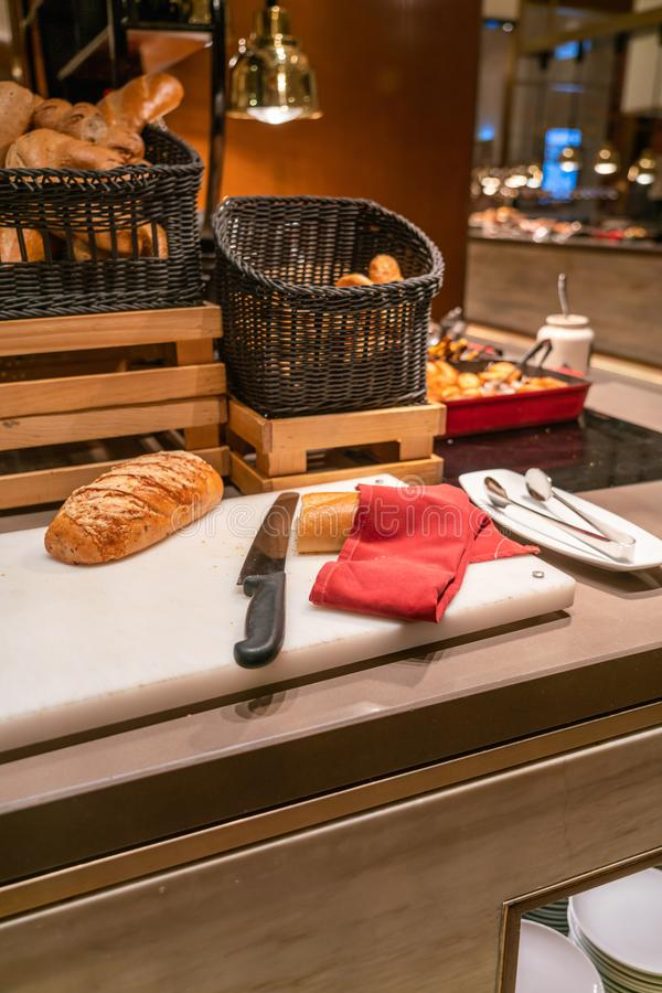 Baguette and cake corner in the buffet restaurant. Vertical photo of Baguette and cake corner in the buffet restaurant royalty free stock image