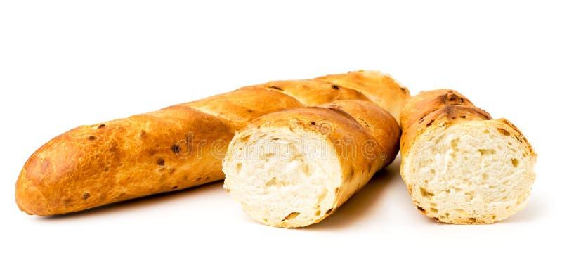 Baguette dell'intero pane e metà irrotta, primo piano fotografia stock