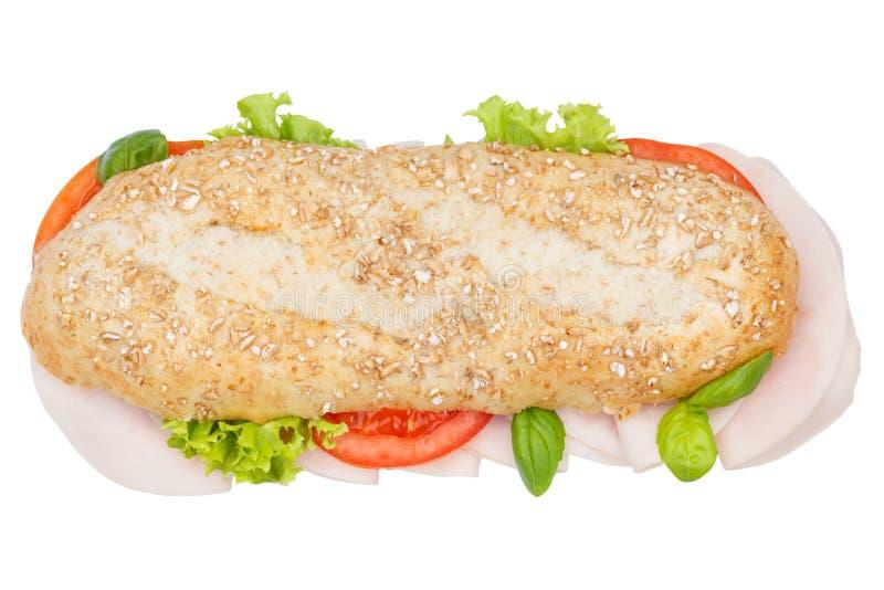 Baguette entero del grano de los granos del bocadillo sub con el jamón desde arriba de la ISO fotografía de archivo