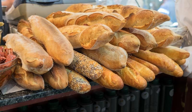 Baguette - long, thin loaf of French bread. For sale at Mahane Yehuda Market, popular marketplace in Jerusalem, Israel royalty free stock image