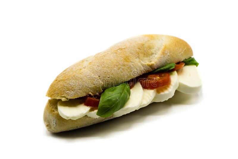 Baguette with mozzarella, basil and tomatoes isolated on white background royalty free stock photo