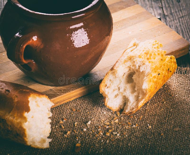 Baguette and old clay pot stock photos