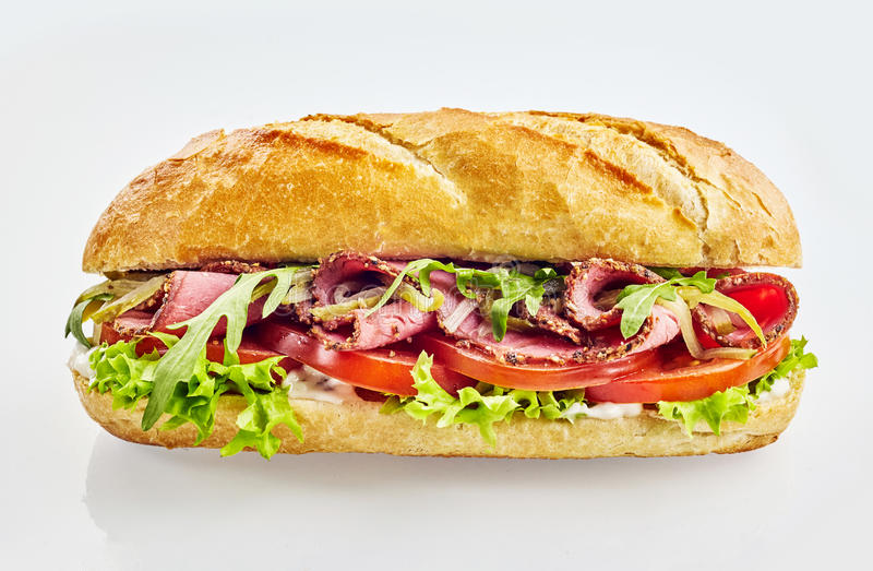 Baguette sandwich with roast beef and vegetables stock photos