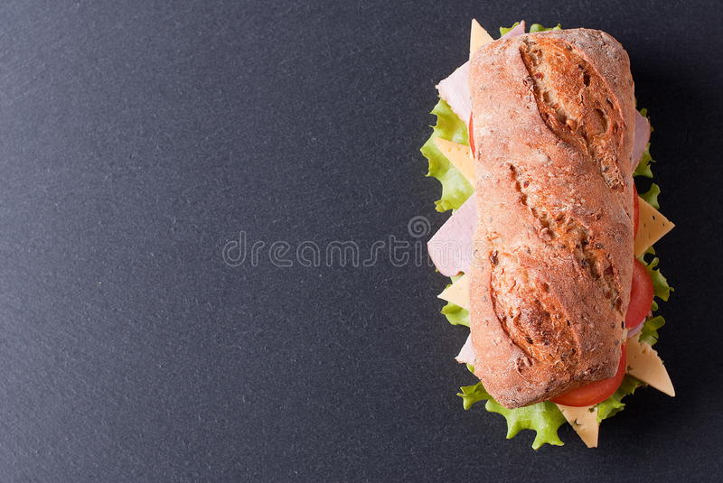Baguette sandwich on the table top view stock images