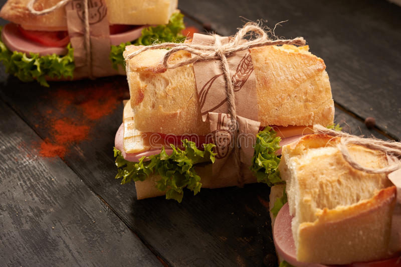 Baguette Sandwiches on the table stock photo