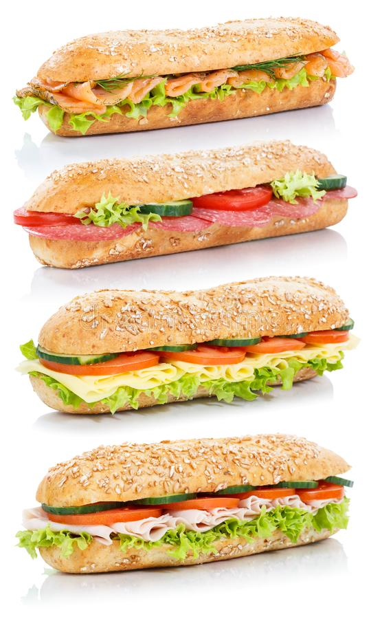 Baguette sub sandwiches with salami ham cheese salmon fish stack. Ed whole grains fresh isolated on a white background royalty free stock photography