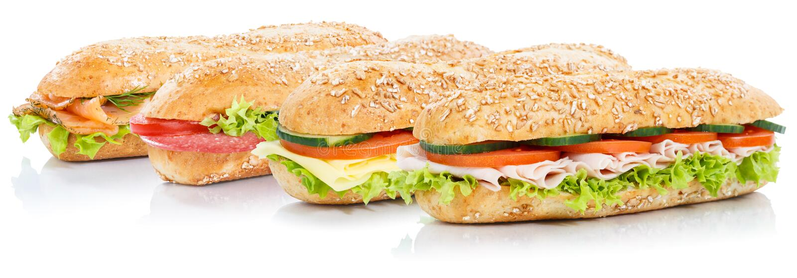 Baguette sub sandwiches with salami ham cheese salmon fish whole. Grains fresh isolated on a white background stock photos