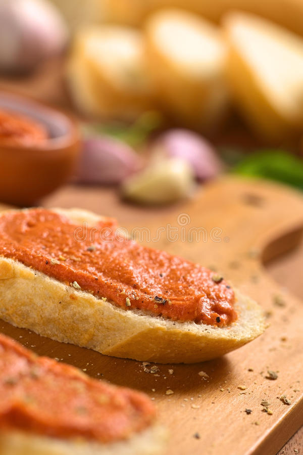 Baguette With Tomato Spread Royalty Free Stock Photos