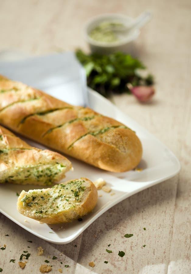 Baguettes avec le beurre persillé photographie stock libre de droits