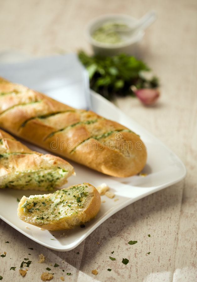 Baguettes with herb butter royalty free stock photography