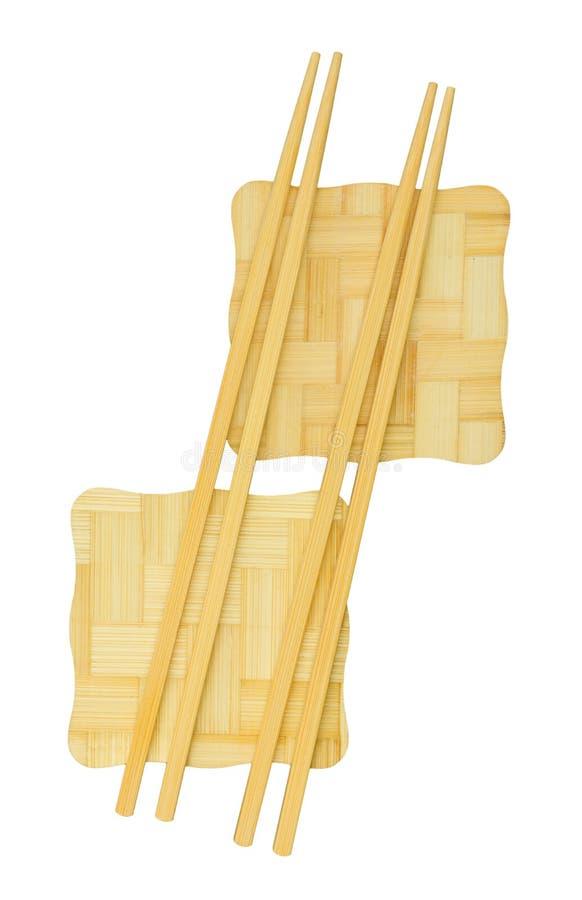 Baguettes sur le support en bambou jaune images stock