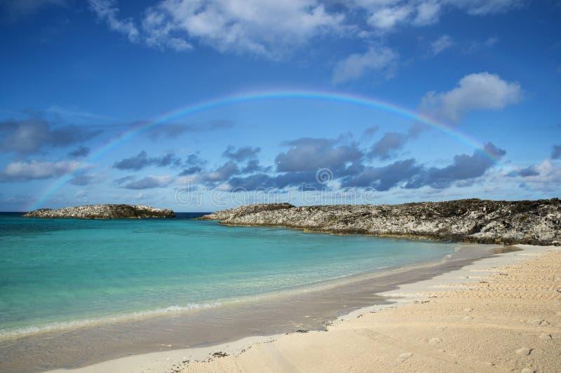 Bahamas Beach Rainbow. Rainbow over a sheltered beach in the Bahamas islands royalty free stock photos