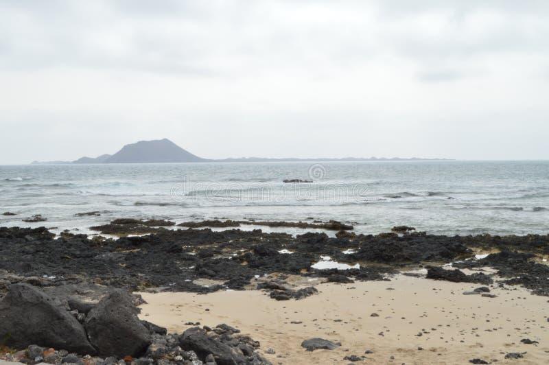 Bahia Full Of Volcanic Stones Near The Dunes In Corralejo. royalty free stock images