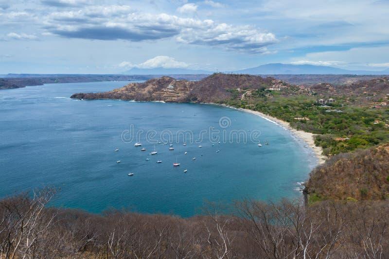 Bahia Hermosa, Guanacaste, Costa Rica. Beautiful view of Hermosa Bay in Guanacaste Costa Rica, with deep blue water and white sand royalty free stock photo