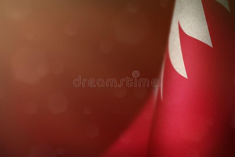 Bahrain flag for honour of veterans day or memorial day. Glory to the Bahrain heroes of war concept on red dark velvet background. Bahrain hanging flag for royalty free illustration