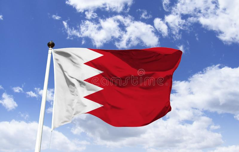 Bahrain flag template floating under a blue sky. Country in the Middle East, more than 30 islands in the Persian Gulf. In modern Capital Manama, Bahrain`s stock images