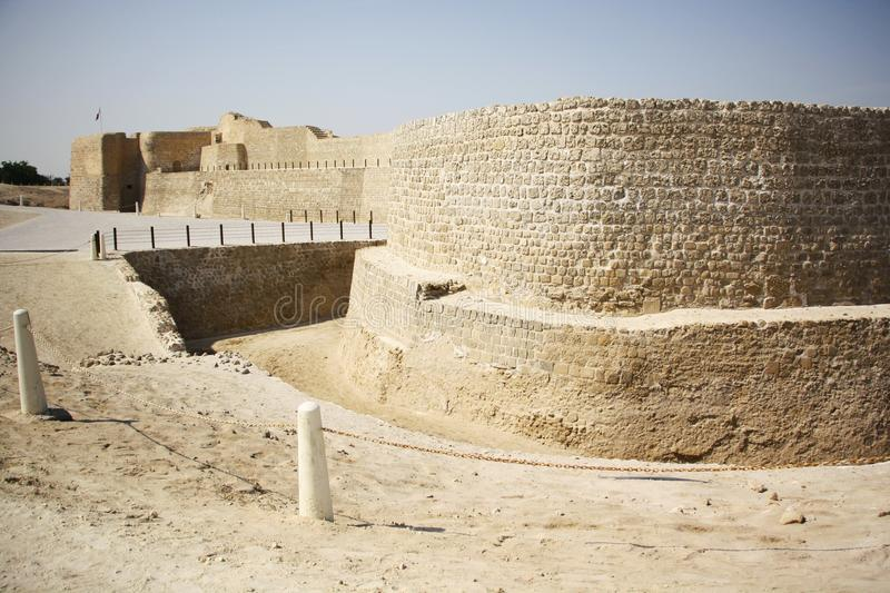Bahrain Fort. Or Fort of Bahrain and previously as the Portugal Fort - archeological site located west of Manama, the capital of Bahrain. The current fort was stock photography