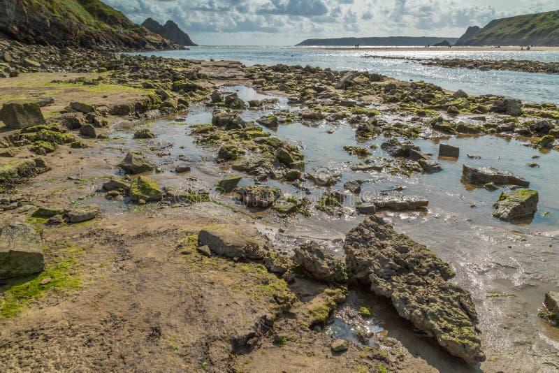 Baie de trois falaises, Swansea, R-U images stock