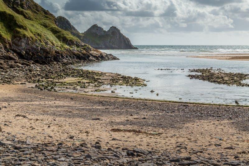 Baie de trois falaises, Swansea, R-U image libre de droits