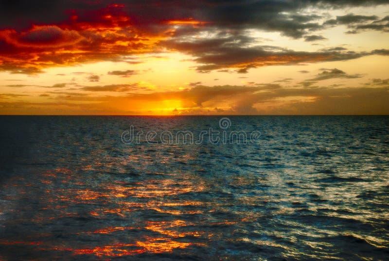 Baie orange St Lucia de Marigot de coucher du soleil photos libres de droits