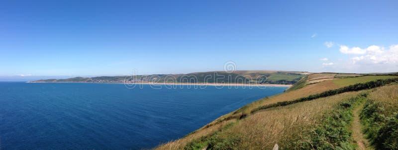 Baie panoramique Devon de woollacombe photo stock