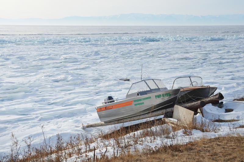 Baikal lake, Russia, March, 01, 2017. Boat of State inspection on the shores of lake Baikal in winter stock image