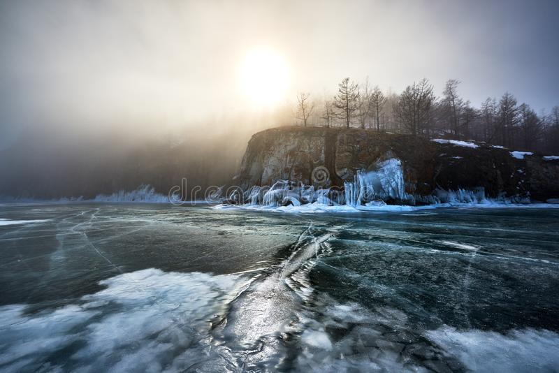 Baikal Lake in winter. With beautiful ice and rocks. The best time to visit - March stock image