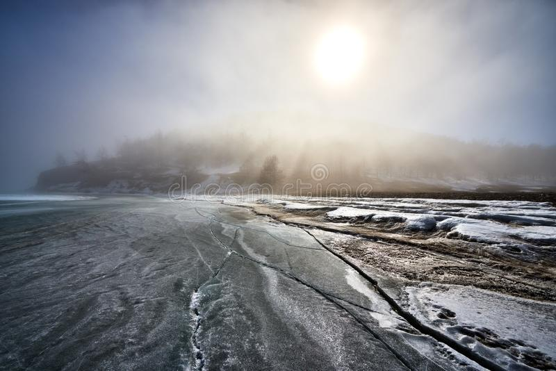 Baikal Lake in winter. With beautiful ice and rocks. The best time to visit - March royalty free stock image