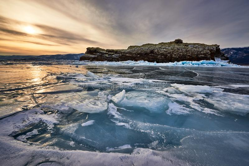 Baikal Lake in winter. With beautiful ice and rocks. The best time to visit - March royalty free stock photography