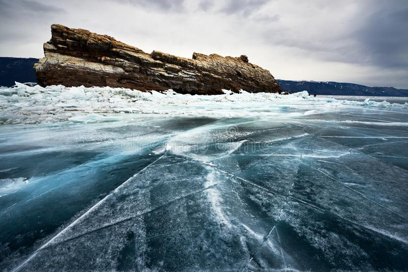 Baikal Lake in winter. With beautiful ice and rocks. The best time to visit - March stock photography