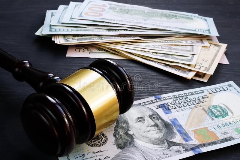 Bail bond and financial penalty. Gavel and money. stock images