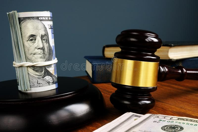 Bail bonds and fine. Money and gavel as symbol of law royalty free stock images