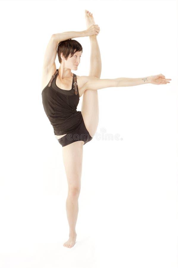 Bailarín creativo de la precisión de la mujer de la yoga imagenes de archivo