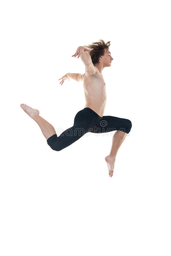 Bailarín de ballet que practica saltos de altura foto de archivo